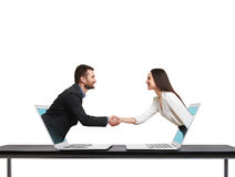 Man and woman come out from laptop Royalty Free Stock Photos