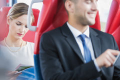 Man and woman commuting Stock Photography