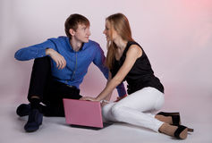 Man and woman at the computer Stock Photography