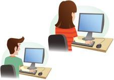 Man and woman at computer monitor royalty free stock photos