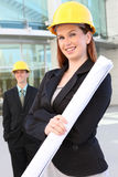 Man and Woman Construction. Man and woman architects on a building construction site royalty free stock images