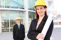 Man and Woman Construction. Man and woman architects on a building construction site royalty free stock photography