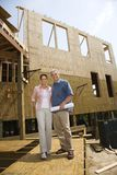 Man and woman on construction site. Stock Photo