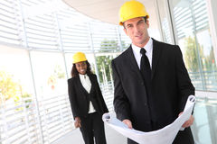 Man and Woman Construction Team Stock Images