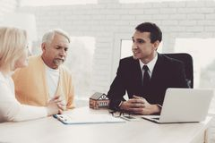 Man and Woman Consulting with Realtor in Office royalty free stock photo