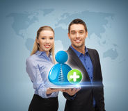 Man and woman with with contact icon Stock Images