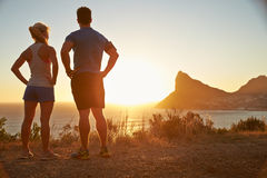 Man and woman contemplating after jogging. Man and women contemplating after jogging stock photos