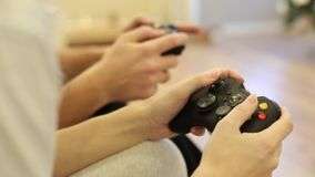 Man and woman with a controller in hands playing video game console. Man and woman with a controller in hands playing video game console stock video