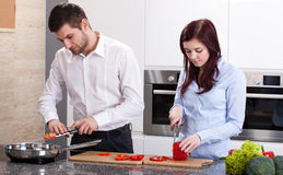 Man and woman cooking dinner Royalty Free Stock Image