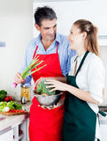 Man and Woman Cooking in Kitchen Royalty Free Stock Photography