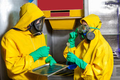 Man and woman cooking meth Stock Images
