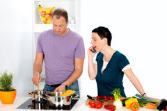 Man and woman cooking together Royalty Free Stock Photography