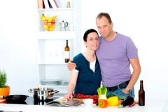 Man and woman cooking together Stock Images
