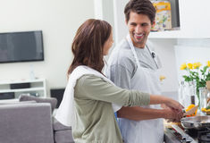 Man and woman cooking together Royalty Free Stock Image