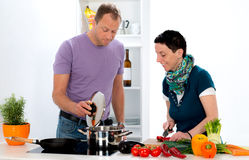 Man and woman cooking together Royalty Free Stock Photo