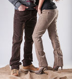A man and a woman in corduroy pants royalty free stock photo