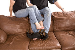 Man and woman on couch Royalty Free Stock Photography