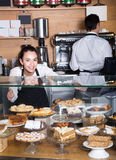 Man and woman at the counter in cafe Royalty Free Stock Photo