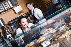 Man and woman at the counter in cafe Royalty Free Stock Images