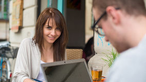 Man and woman couple in the cafe on laptop computer. Man and women couple in the cafe on laptop computer. They are happy Stock Photography