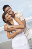 Man and Woman Couple Embracing On A Beach Stock Photo