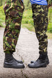 Man woman couple feet in military boots Royalty Free Stock Images