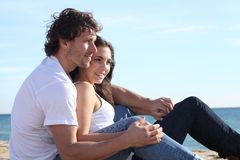 Man and woman couple flirting. Man and women couple flirting in the beach royalty free stock photography