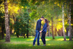 Man and woman couple flirting in a park Royalty Free Stock Photo
