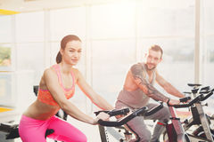 Man and woman, couple in gym on exercise biles Stock Image