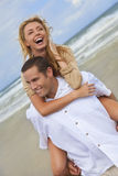 Man and Woman Couple Having Fun On A Beach Royalty Free Stock Photos