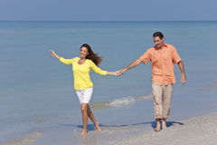 Man & Woman Couple Holding Hands on a Beach Stock Photography