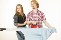 Man and woman couple ironing clothes royalty free stock images