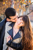 Man woman couple kissing portrait sunny Stock Photos