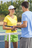 Man Woman Couple Playing Tennis or Lesson stock photography