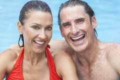 Man & Woman Couple Relaxing In Swimming Pool Stock Image