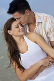 Man and Woman Couple In Romantic Embrace. A young man and woman embracing as a romantic couple on a beach Stock Photos
