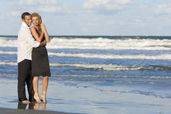 Man and Woman Couple In Romantic Embrace On Beach Royalty Free Stock Photo
