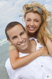Man and Woman Couple In Romantic Embrace On Beach Stock Images