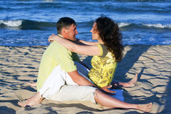Man and Woman Couple In Romantic Embrace On Beach Stock Photography