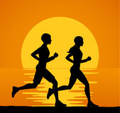 Man and Woman, couple running jogging training exercising together Stock Photography