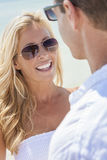 Man Woman Couple In Sunglasses on Beach Stock Image