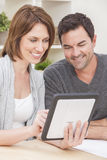 Man & Woman Couple on Tablet Computer at Home royalty free stock image
