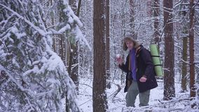 Man and woman couple is throwing snowballs to each other together in a snow winter forest. young man plays snowballs in. The forest. hd stock video