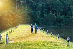 Man and woman couple walking at beautiful sunny morning at pang ung lake park in Thailand Royalty Free Stock Photos