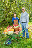 Man and woman with crop of vegetables Stock Image