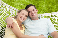 Man and Woman Cuddling in Hammock Stock Images
