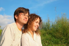 Man and woman is cuddling in sunny meadow Royalty Free Stock Photography