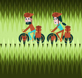 Man and woman cycling on greenfield road. Bike tour concept. Royalty Free Stock Photo