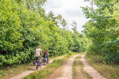 Man and woman cycling in a large nature reserve Royalty Free Stock Image