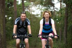 Man and woman cyclist smiling outdoors Royalty Free Stock Photos